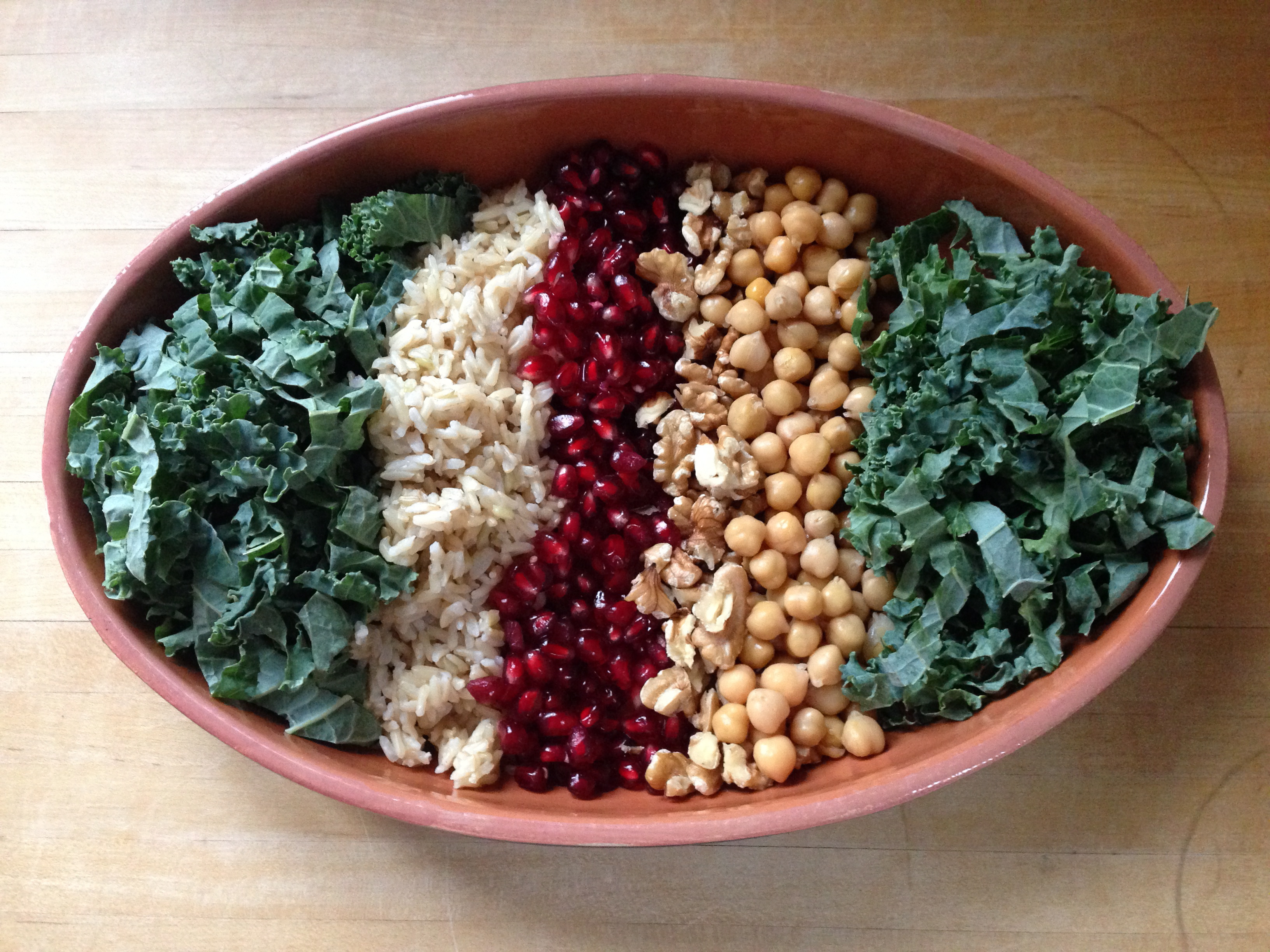 Kale, brown rice, pomegranates, raw walnuts, chickpeas and more kale.