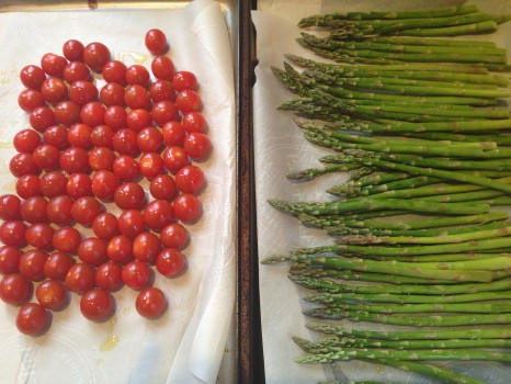 Toss grape tomatoes and asparagus with olive oil, sea salt and pepper. Roast 'em.