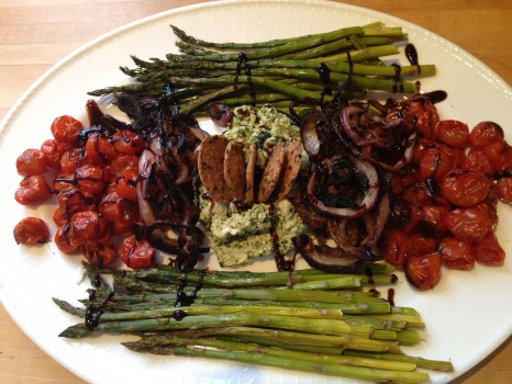 Make dip: Warm goat cheese in oven, then combine with pesto. Arrange veggies around dip, drizzle with balsamic glaze and