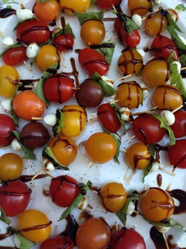 Mini tomato, bocconcini and basil skewers with balsamic glaze. Basically a mini version of this.