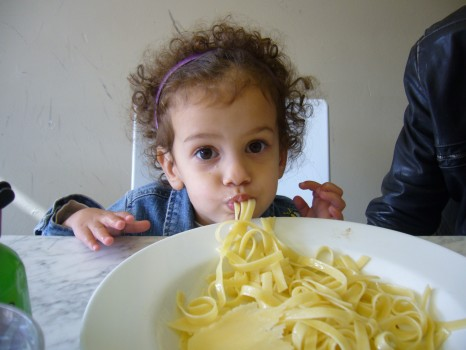Lily, pre-diagnosis, eating big bowl of fettucine.