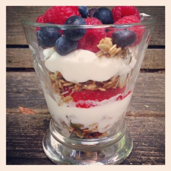 Eating homemade granola yogurt parfait with fresh seasonal berries on my back porch.