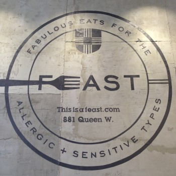 FEAST is located at 881 Queen St. W.